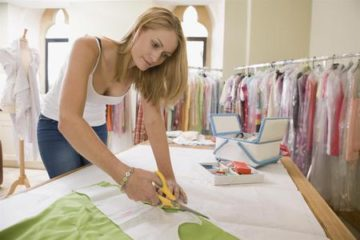 fashion designer cutting fabric