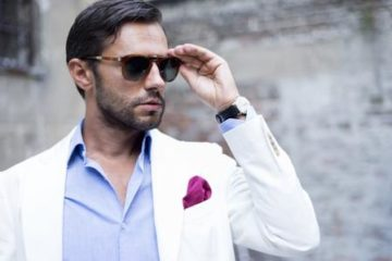 male model holding sunglasses