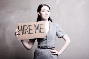 woman holding hire me sign