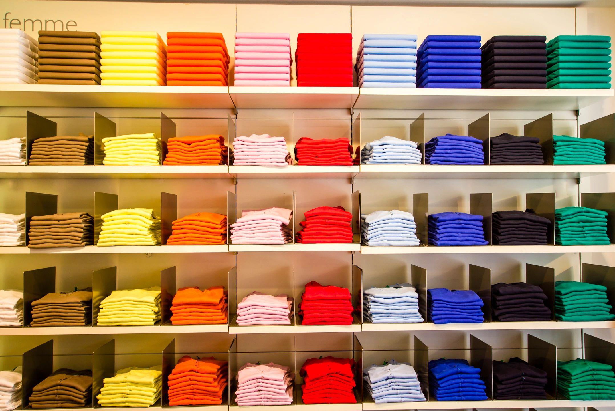 neatly organized colored shirts